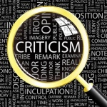 CRITICISM. Magnifying glass over different association terms.