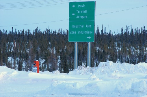 Exit from Inuvik Airport, showing the boreal forest