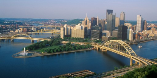 Liberty Bridge over Allegheny River at sunset with Pittsburgh skyline